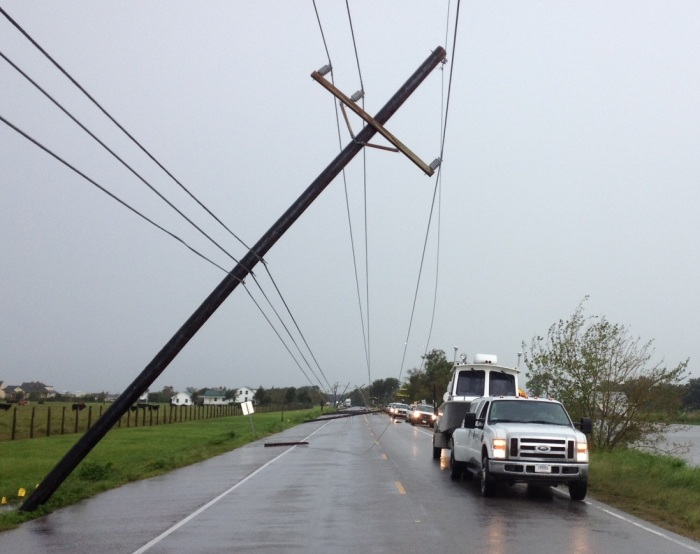 Escorted by harbor police after Hurricane Isaac, the Coast Survey navigation response team had to skirt downed utility poles and hanging wires on closed Hwy 1, as they made their way from Lafayette to Port Fourchon.