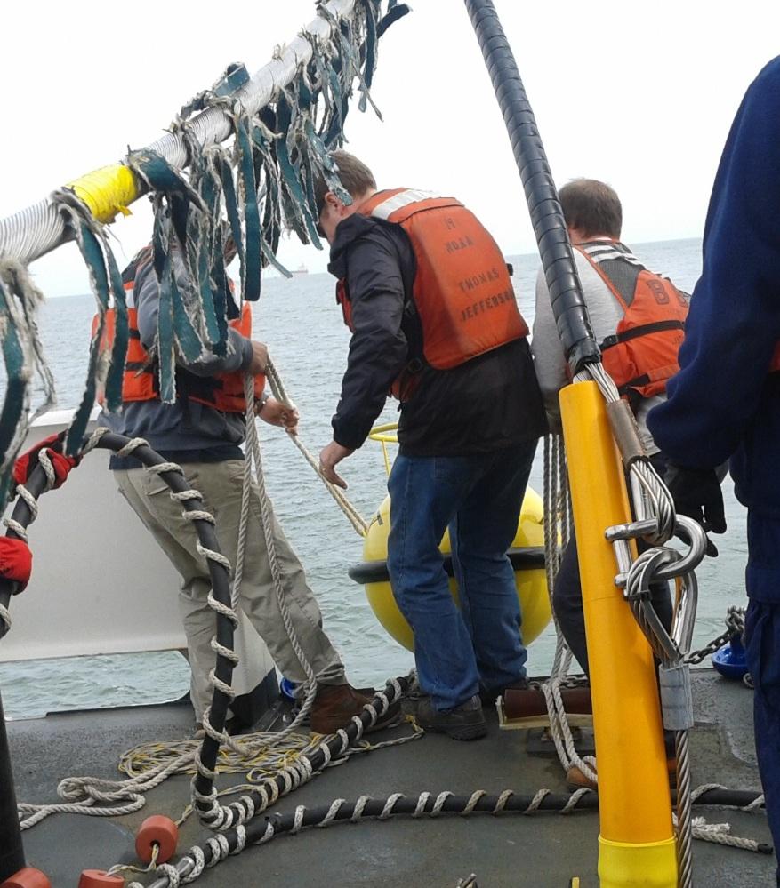 Deploying GPS tide buoy from TJ