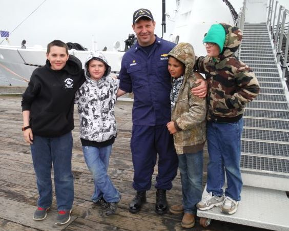 Cmdr. Rick Brennan with friends -- and potential hydrographers.
