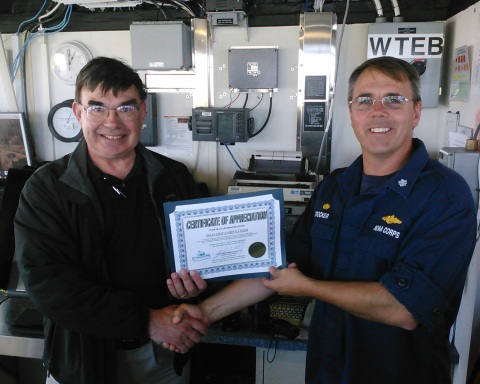 Capt. Kip Louttit, executive director of the Marine Exchange of Southern California San Pedro, presents a certificate of appreciation to Fairweather's commanding officer, Cmdr. James Crocker.