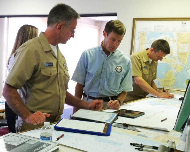 Coast Survey's Capt. Jon Swallow and Rear Adm. Gerd Glang review charting and survey requirements with Capt. Andrew Melick of of the Biscayne Bay Pilots Association.