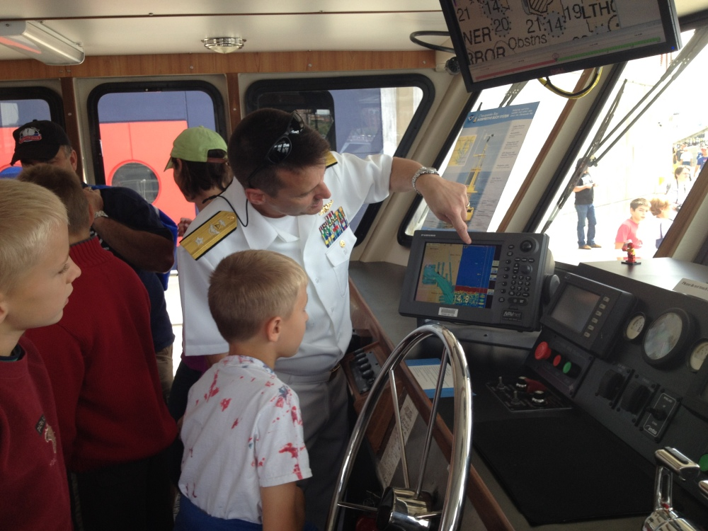 Rear Adm. Gerd Glang explains charts to kids