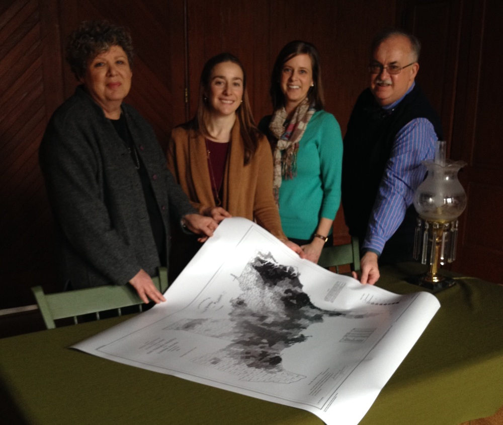 Dawn Forsythe (Coast Survey), Erin Carlson Mast and Callie Hawkins (Lincoln's Cottage), and Ben Sherman (NOAA) with the slave density map in the Lincoln Cottage library.