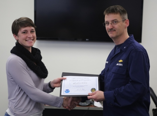 RDML Gerd Glang awarded training completion certificates. Here, Danielle Power receives her certificate. Photo by U.S. Coast Guard Auxiliarist Jonathan Roth.