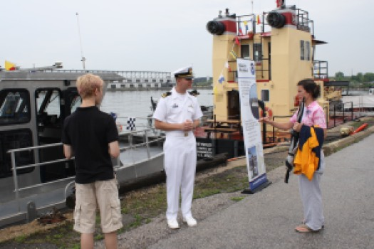 Lt.j.g. Bart Buesseler, the Officer in Charge of Bay Hydro II, answers questions along side Bay Hydro II during the Port of Baltimore's National Maritime Day event.