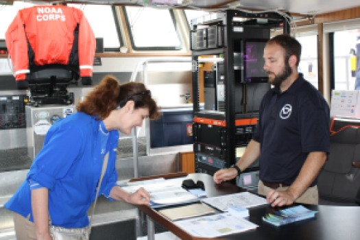 Matt Carter, Survey Technician,  answers questions about surveying and charting aboard the Bay Hydro II.