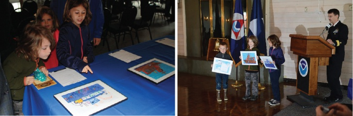 Art contest winners admire their artwork and are recognized by Rear Admiral Glang during the ceremony.