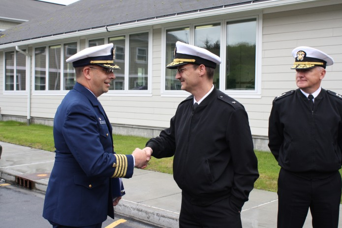 Captain Jeffrey Westling, Commanding Officer of USCB Base Kodiak and Rear Admiral Glang exchange command coins following a tour of the base.