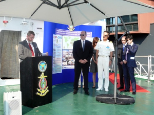 His Serene Highness Prince Albert of Monaco and Captain Tetsushi Mitsuya, commanding officer of the training ship Kojima of Japan Coast Guard, stand alongside Robert Ward, President of the IHO, during his remarks on board the Kojima