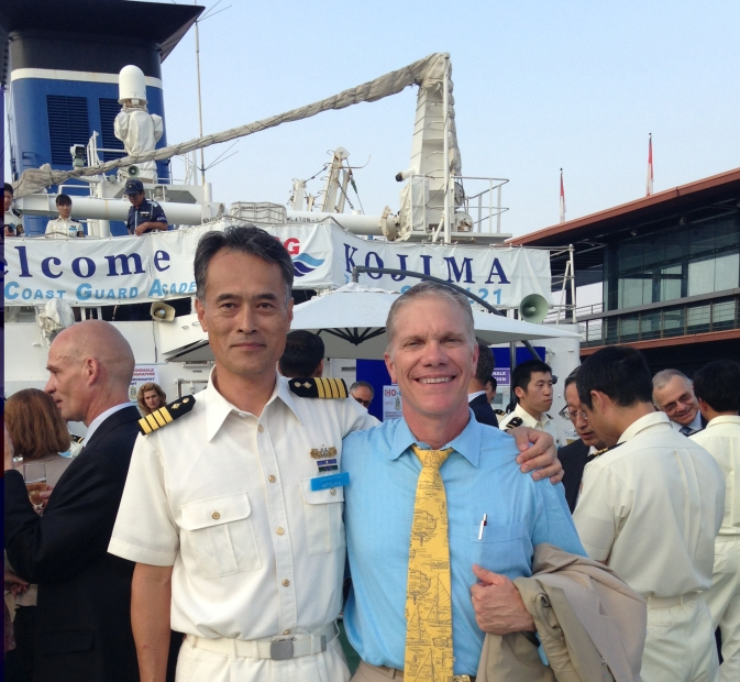 Coast Survey's Tom Loeper and Captain Tetsushi Mitsuya, commanding officer of the training ship Kojima of Japan Coast Guard, attend the IHO event onboard the Kojima.