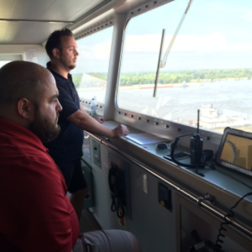 Guy Funnell (standing) observes navigational challenges of the Mississippi River, with NOBRA pilot Jason Ledet.