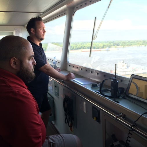 Guy Funnell (standing) observes navigational challenges of the Mississippi River, with NOBRA pilot Jason Ledet.
