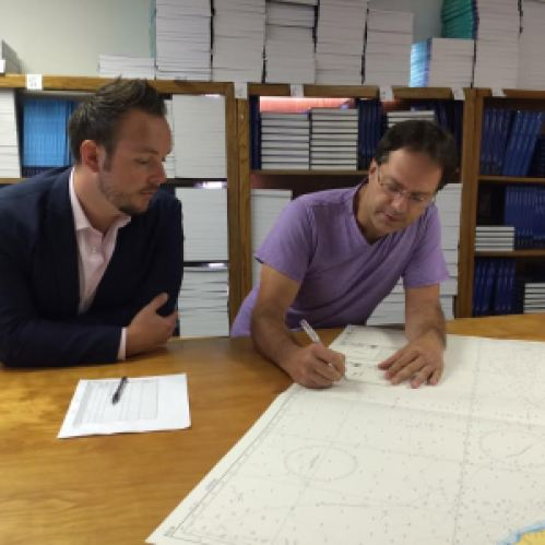 Guy Funnell (left) meets with NOAA-certified print-on-demand chart sub-agent Horizon Nautical.
