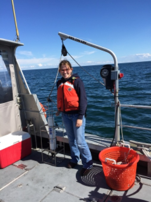 Valerie taking a CTD (Conductivity, Temperature, and Depth) cast to measure sound speed in the water.