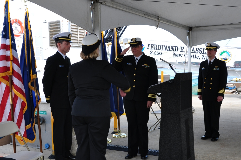 Lt. Cmdr. accepts command of NOAA Ship Ferdinand R. Hassler as Cmdr. Marc Moser looks on.