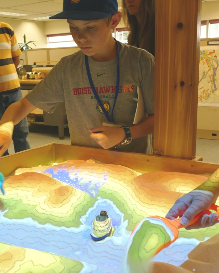 Campers interact with augmented reality topographic sandbox.