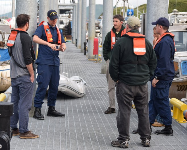 Launch crews hold morning safety meeting at the pier.