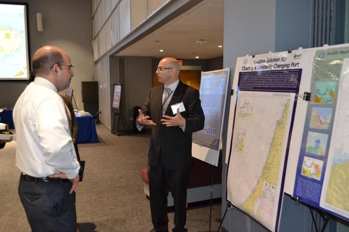 Dr. Shachak Pe'eri guides Ben Friedman, NOAA Administrator, through the poster session.