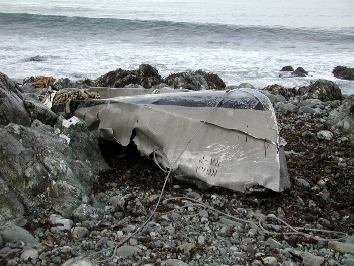 Wreckage of Rainier launch washed ashore in Resurrection Bay, Alaska.