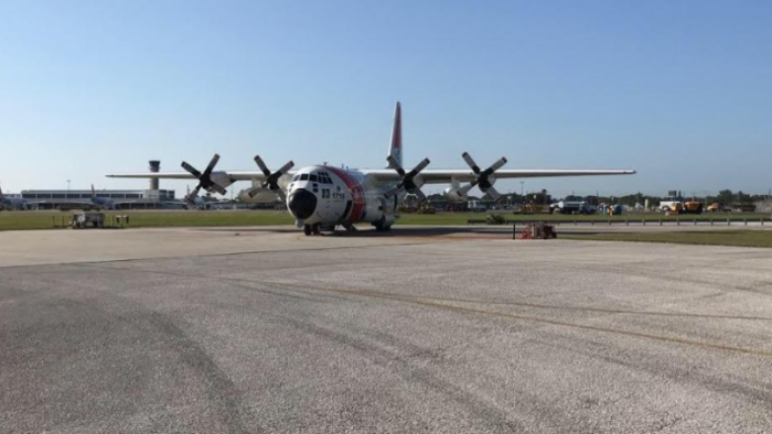 NOAA loads the MIST kit and crew on board the USCG C-130 aircraft at Naval Air Station Jacksonville.