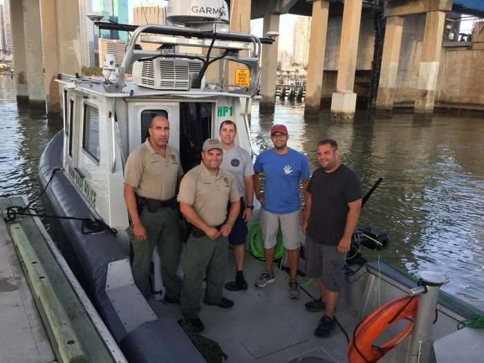 Miami-Dade police officers Abel Lopez and Levy Semino, the NOAA Coast Survey MIST team.