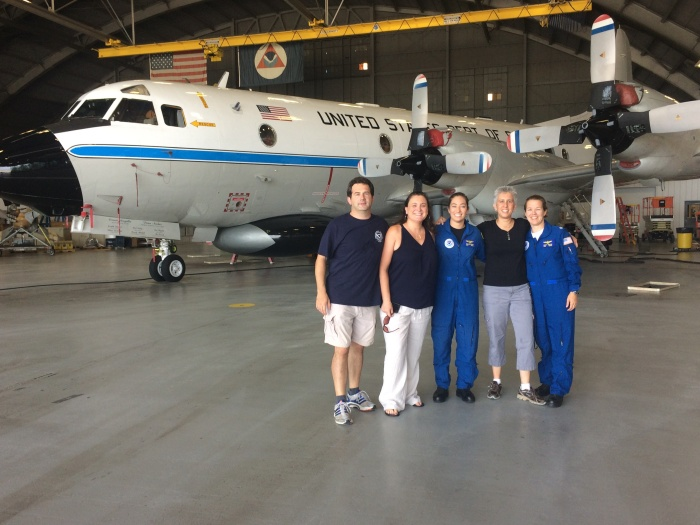The production team interviewed two film subjects on location at the Aviation Operation Center in Tampa, Florida. (Left to right) Bob Schwartz (NOAA Office of Communications), Crescent Moegling (Co-Producer; NOAA Office of Coast Survey), Lt. j.g. Shanae Coker (NOAA Corps), Timi Vann (Producer; National Weather Service), and Cmdr. Cathy Martin (NOAA Corps). The team also included Lt. Cmdr. Fionna Matheson as a technical advisor and worked under the leadership endorsement of Rear Adm. Anita Lopez (NOAA ret.).