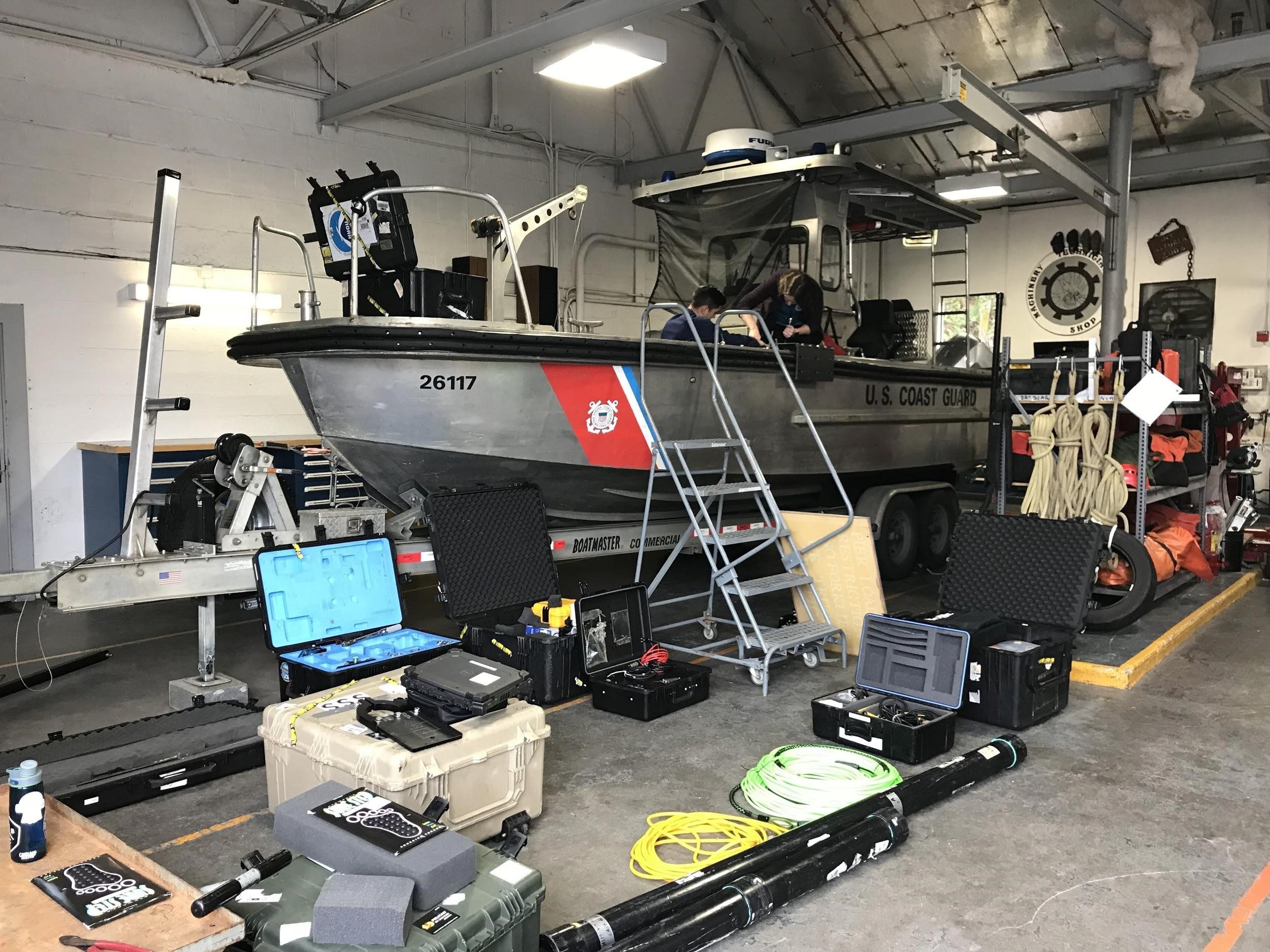 Setting up the MIST equipment on a USCG TANB vessel