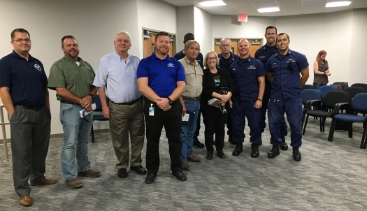 NOAA's southeast navigation manager, Kyle Ward (left) meets with USCG, Port Authority and other representatives of the Maritime community at the pre-hurricane meeting hosted at Port Canaveral, Florida.