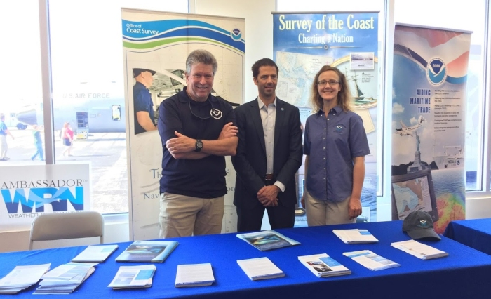 Tim Osborn (left), the navigation manager for the east Gulf Coast, Dr. Neil Jacobs (center), Assistant Secretary of Commerce for Environmental Observation and Prediction
