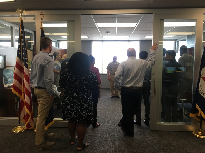 Rear Adm. Shep Smith greets the workshop attendees as they begin a tour of the Coast Survey offices in Silver Spring, Maryland