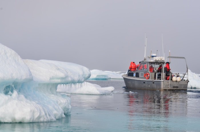 A launch from NOAA Ship Fairweather surveys near ice in the U.S. Arctic.