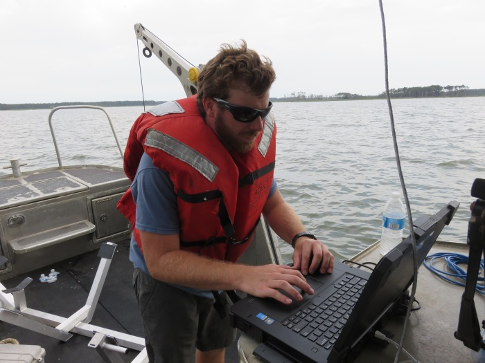 Alex Ligon (NOAA NRT 1) watches the ASV data in real-time. The ability to watch the data real time allows real-time decision making for survey planning and preliminary products to be provided to the Coast Guard ANT.